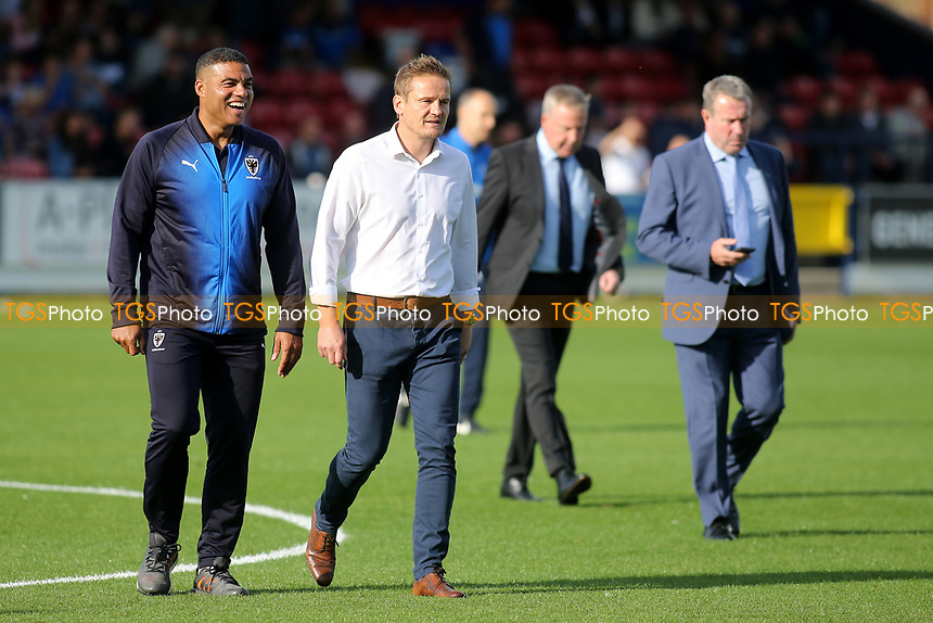 AFC Wimbledon Manager, Neal Ardley, walks across the pitch to the dugout ahead of kick-off during AFC Wimbledon vs Portsmouth, Sky Bet EFL League 1 Football at the Cherry Red Records Stadium on 13th October 2018