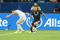CARSON, CA - SEPTEMBER 15: Graham Zusi #8 of Sporting Kansas City moves past Cristian Pavon #10 of the Los Angeles Galaxy during a game between Sporting Kansas City and Los Angeles Galaxy at Dignity Health Sports Complex on September 15, 2019 in Carson, California.