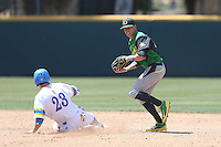 Mark Karaviotis #24 of the Oregon Ducks forces out Brett Stephens #23 of the UCLA Bruins at second base and throws to first base during a game at Jackie Robinson Stadium on May 18, 2014 in Los Angeles, California. Oregon defeated UCLA, 5-4. (Larry Goren/Four Seam Images)
