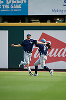 Charlotte Stone Crabs center fielder Tanner Dodson (10) catches a fly ball in front of right fielder Carl Chester (9) during a Florida State League game against the Bradenton Marauders on April 10, 2019 at LECOM Park in Bradenton, Florida.  Bradenton defeated Charlotte 2-1.  (Mike Janes/Four Seam Images)