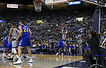 Nevada's Cody Martin (11) shoots a three pointer against South Dakota State in the first half of an NCAA college basketball game in Reno, Nev., Saturday, Dec. 15, 2018. (AP Photo/Tom R. Smedes)
