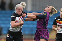 Picture by Paul Currie/SWpix.com - 07/10/2017 - Rugby League - Women's Super League Grand Final - Bradford Bulls v Featherstone Rovers - Regional Arena, Manchester, England - Beth Sutcliffe of Bradford Bulls is tackled by Sinead Poach of Featherstone Rovers