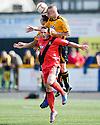 East Fife's Gareth Wardlaw is out jumped by Daryll Meggatt.