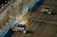 Apr 11, 2008; Avondale, AZ, USA; NASCAR Nationwide Series driver John Young sparks after hitting the wall during the Bashas Supermarkets 200 at the Phoenix International Raceway. Mandatory Credit: Mark J. Rebilas-