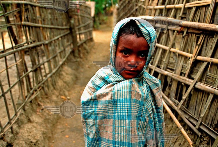 A boy wrapped up on a winter morning on Kutubdia Island in the Bay of Bengal.