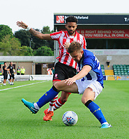 Lincoln City's Bruno Andrade vies for possession with Sheffield Wednesday's Jordan Thorniley<br /> <br /> Photographer Chris Vaughan/CameraSport<br /> <br /> Football Pre-Season Friendly - Lincoln City v Sheffield Wednesday - Friday 13th July 2018 - Sincil Bank - Lincoln<br /> <br /> World Copyright &copy; 2018 CameraSport. All rights reserved. 43 Linden Ave. Countesthorpe. Leicester. England. LE8 5PG - Tel: +44 (0) 116 277 4147 - admin@camerasport.com - www.camerasport.com