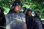 KASANGULU, DEMOCRATIC REPUBLIC OF CONGO APRIL 25: Unidentified riot policemen do a demonstration during a graduation ceremony on April 25, 2006 in Kasangulu, outside Kinshasa, Congo, DRC. The European Union has a cooperation and training program with the Congolese police. They trained the integrated Police Unit (UPI) at the Police school here. European standard training and equipment was given to them. These riot police are to be deployed during the upcoming election campaign and elections in Congo, DRC. The country is in ruins after forty years of mismanagement by the corrupt dictator and former president Mobuto Sese Seko. He fled the country in 1997 and a civil war started. The country is planning to hold general elections by July 2006, the first democratic elections in forty years. (Photo by Per-Anders Pettersson)