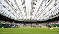 London, England, 2 July, 2016, Tennis, Wimbledon, Overall view of centercourt with closed roof during the match of  Kiki Bertens (NED) (L)  against Simona Halep (ROU)<br /> Photo: Henk Koster/tennisimages.com