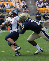 Pitt linebacker Brandon Lindsey sacks Maine quarterback Warren Smith. . The Pitt Panthers beat the Maine Black Bears 35-29 at Heinz Field, Pittsburgh, PA on September 10, 2011.