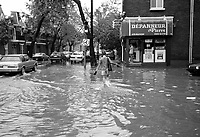 July 14, 1987  File Photo -  A fierce flash flood struck Montreal on July 14, 1987. As severe thunder storms and intense rainfall deluged the city, drainage systems were unable to accommodate the massive runoff. Major expressways were flooded with over 3 metres of water, requiring that people be rescued from their cars. The public transportation system was in chaos. Backed up sewers flooded houses and businesses, and thousands were without electricity.<br /> <br /> Montreal had been experiencing a heat wave when on July 14, thunder storms dumped in excess of 100 millimetres (mm) of rain. A recording station at McGill University measured 86 mm of rain in a one-hour period. Rainfalls measuring 100 mm at Parc Lafontaine, 92 mm at the Botanical Gardens, and 99 mm at Dorval Airport were also recorded. Accompanying the thunderstorms were tremendous winds that uprooted large trees and toppled hydro lines.