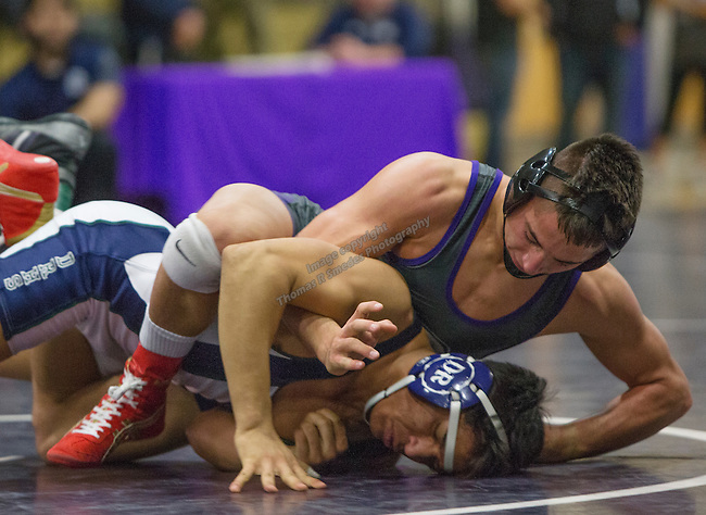 Damonte Ranch senior Michael Solferino, top, wrestles Spanish Springs junior Cole Drescher in the 152-pound weight class during the NIAA Division I Northern Region Wrestling Championships held at Spanish Springs High School on Saturday, Feb. 13, 2016.  Dresscher won the match.
