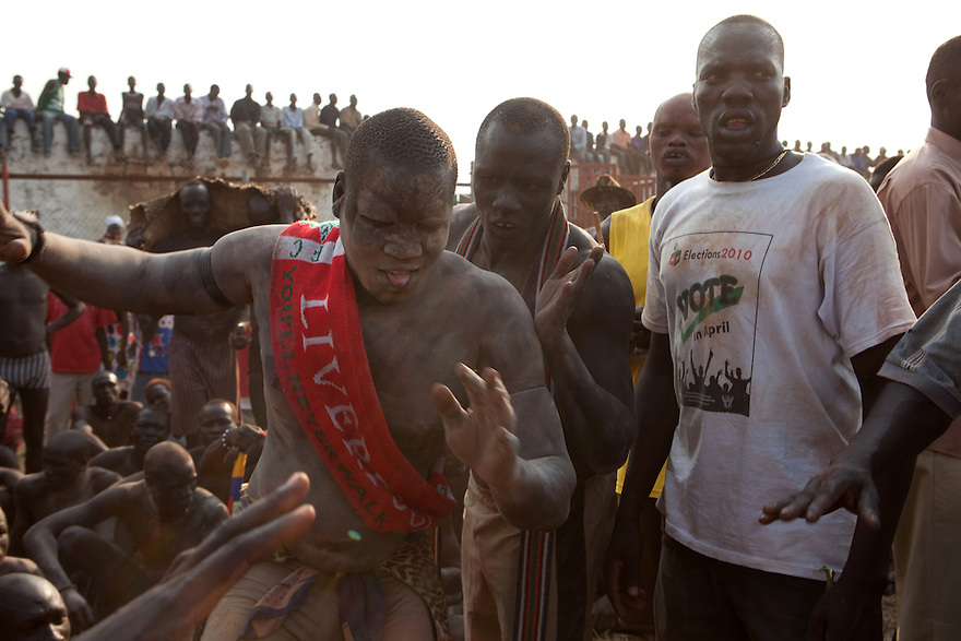 Sunday 5 december 2010 - Juba, Southern Sudan - Mundari wrestlers before the match. Traditional wrestling matches in Juba Stadium between Dinka wrestlers from Yirol East of Lake State and Mundari wrestlers from Terekeka County of Central Equatoria State. The matches attracted large numbers of spectators who sang, played drums and danced in support of their favorite wrestlers. The match organizers hoped that the sport would bring together South Sudan's many different tribes. Photo credit: Benedicte Desrus