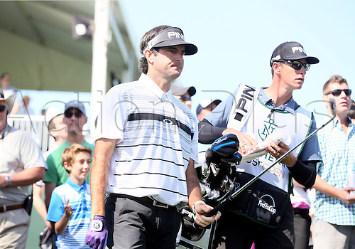 20.02.2016. Pacific Palisades, California, USA.  Bubba Watson and caddie Ted Scott look ahead to see where to hit the ball during the third round of the Northern Trust Open at Riviera Country Club in Pacific Palisades, CA.