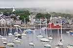 Fog lifting from Rockport Harbor, Rockport, MA, USA