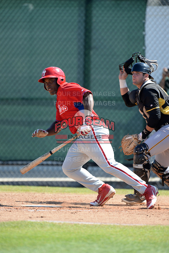 Philadelphia Phillies infielder William Carmona (31) and catcher Mike Spano (55) watch a hit during a minor league spring training game against the Pittsburgh Pirates on March 18, 2014 at the Carpenter Complex in Clearwater, Florida.  (Mike Janes/Four Seam Images)
