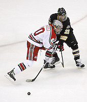 Ohio State's Darik Angeli (10) battles with Western Michigan's Mike Cichy (25) during a NCAA hockey game at Value City Arena, Friday, Feb. 15, 2013 in Columbus, Ohio. (Photo for the Dispatch by Mike Munden)