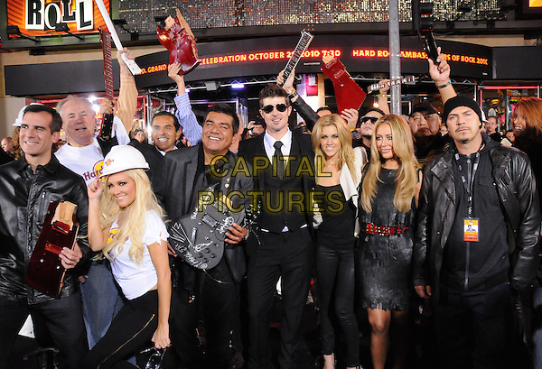 Bridget Marquardt, George Lopez, Robin Thicke, Ashley Roberts, Aubrey O'Day and otThers.The Hard Rock Cafe Hollywood's grand opening party in Hollywood, California, USA..October 21st, 2010.full length white t-shirt black trousers  hard hat guitar broken arms in air sunglasses shades destroyed goggles scarf group short half.CAP/RKE/DVS.©DVS/RockinExposures/Capital Pictures.