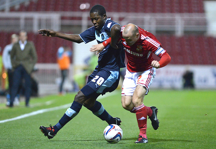 Burnley's Marvin Bartley battles with Swindon Town's Alan McCormack ..Football - Capital One Cup Third Round - Swindon Town v Burnley - Tuesday 25th September 2012 - The County Ground - Swindon. .