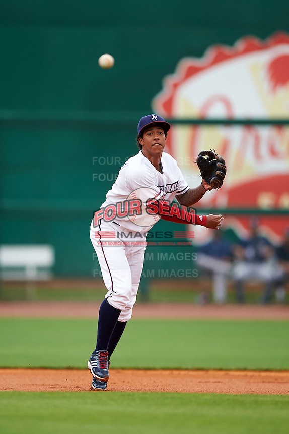 NW Arkansas shortstop Raul Mondesi (2) throws to first during a game against the San Antonio Missions on May 31, 2015 at Arvest Ballpark in Springdale, Arkansas.  NW Arkansas defeated San Antonio 3-1.  (Mike Janes/Four Seam Images)
