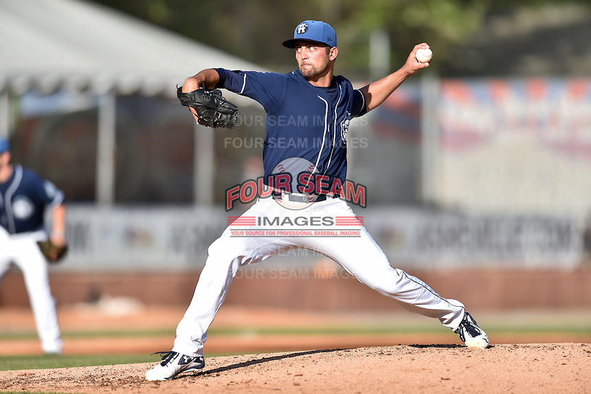 Asheville Tourists starting pitcher Dylan Craig (18) delivers a pitch during a game against the Hagerstown Suns at McCormick Field on April 28, 2016 in Asheville, North Carolina. The Tourists were leading the Suns 6-5 when the game was delayed in the top of the 6th inning due to darkness. (Tony Farlow/Four Seam Images)