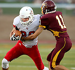 HARRISBURG, SD - SEPTEMBER 25: Tyler Hintz #26 from Brandon Valley looks to shake the grasp of Lucas Koolstra #11 from Harrisburg in the first quarter of their game Friday night at Harrisburg. (Photo by Dave Eggen/Inertia)