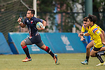 Muhammad Azwan Zuwairi Bin Mat Zizi (l) of Malaysia runs with the ball during the match between Malaysia and Thailand of the Asia Rugby U20 Sevens Series 2016 on 12 August 2016 at the King's Park, in Hong Kong, China. Photo by Marcio Machado / Power Sport Images