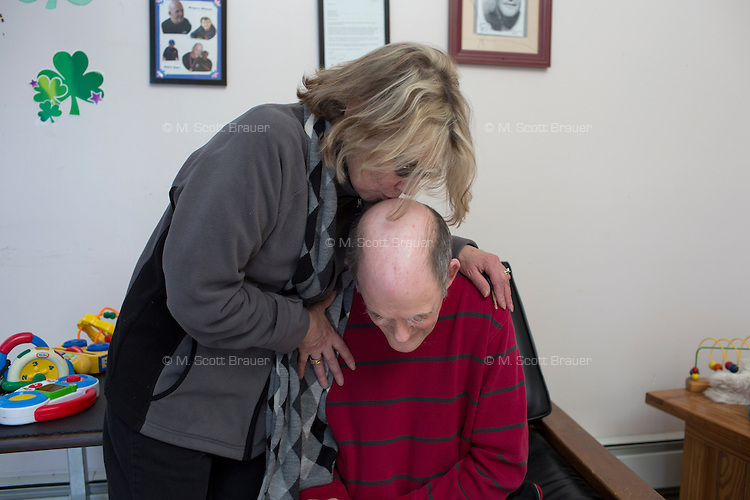 Regina Davidson, sister of resident Marilyn Davidson, kisses Jack Walsh, 62, a longtime resident of the Fernald Developmental Center in Waltham, Massachusetts, USA.  Regina Davidson now serves as Jack's guardian. Jack has been diagnosed with profound mental retardation and cannot speak.