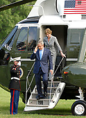 Washington, D.C. - June 11, 2007 -- United States President George W. Bush, left, salutes as he and and first lady Laura Bush, right, return to the White House aboard Marine 1 after an eight day visit to Europe in Washington, D.C. on Monday, June 11, 2007.  <br /> Credit: Ron Sachs - Pool