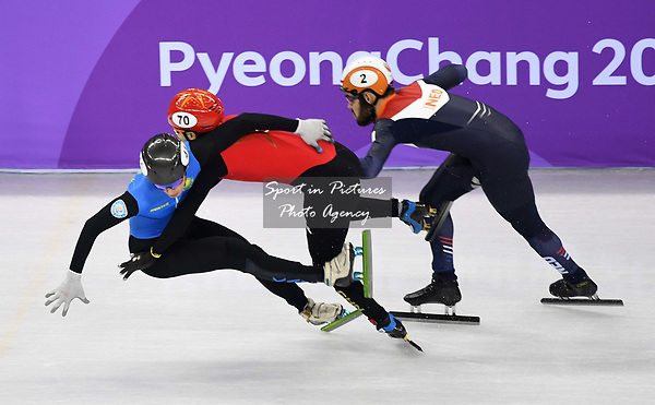 Hongzhi Xu (CHN, 70) and Nurgergen Zhumagaziyev (KAZ) crash. Short track. Gangneung ice arena. Pyeongchang2018 winter Olympics. Gangneung. Republic of Korea. 10/02/2018. ~ MANDATORY CREDIT Garry Bowden/SIPPA - NO UNAUTHORISED USE - +44 7837 394578