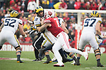 Wisconsin Badgers linebacker Garret Dooley (5) sacks Michigan Wolverines quarterback Brandon Peters (18) during an NCAA College Big Ten Conference football game Saturday, November 18, 2017, in Madison, Wis. The Badgers won 24-10. (Photo by David Stluka)