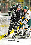 29 December 2014: Providence College Friar Defenseman Kyle McKenzie, a Sophomore from Aston, PA, works against UVM Forward Brendan Bradley, a Sophomore from Warminster, PA, during second period action against the University of Vermont Catamounts in the deciding game of the annual TD Bank-Sheraton Catamount Cup Tournament at Gutterson Fieldhouse in Burlington, Vermont. The Friars shut out the Catamounts 3-0 to win the 2014 Cup. Mandatory Credit: Ed Wolfstein Photo *** RAW (NEF) Image File Available ***