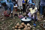 A woman sells coconuts in a weekly market in Despagne, an isolated village in southern Haiti where the Lutheran World Federation has been working with residents to improve their quality of life.