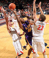 Jan. 2, 2011; Charlottesville, VA, USA; LSU Tigers guard Aaron Dotson (45) tries to shoot between Virginia Cavaliers guard Joe Harris (12) and Virginia Cavaliers forward Will Sherrill (22) during the game at the John Paul Jones Arena. Virginia won 64-50. Mandatory Credit: Andrew Shurtleff-