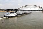 Barge beneath Waalbrug bridge, River Waal, Nijmegen, Gelderland, Netherlands
