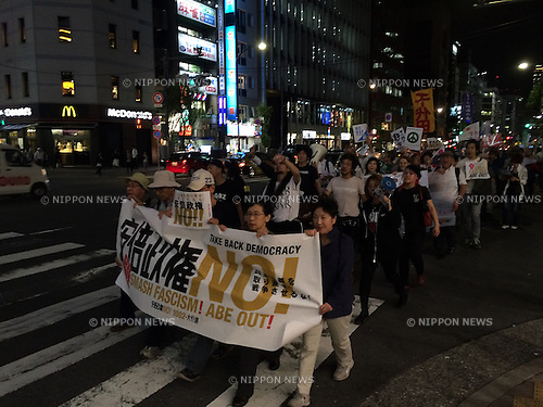 Members of SEALDs (Students Emergency Action for Liberal Democracy) and other groups march in protest against the Japanese government of Prime Minister Shinzo Abe on Friday 2nd October, in the Ginza district of Tokyo Japan. In the largest gathering since the Japanese government passed new controversial security legislation, students and other Japanese citizens came together on Friday night to call for a change in government. Under the slogan Smash Fascism, Abe Out, the protests were organised by several different groups all unhappy with the actions of the current government. As well as the security bills, the protesting groups have a long list of gripes with the Abe government, including the restart of Japan's nuclear power programme, the State Secrecy Law, consumption tax rises, the Trans Pacific trade Partnership, and US military base relocation in Okinawa. They believe that the government is pushing on regardless and not paying attention to their concerns. On many of the issues the protesters have the support of the much of the population but the Liberal Democratic Party has a strong majority in parliament and has just selected Abe as president for another 3-year term.