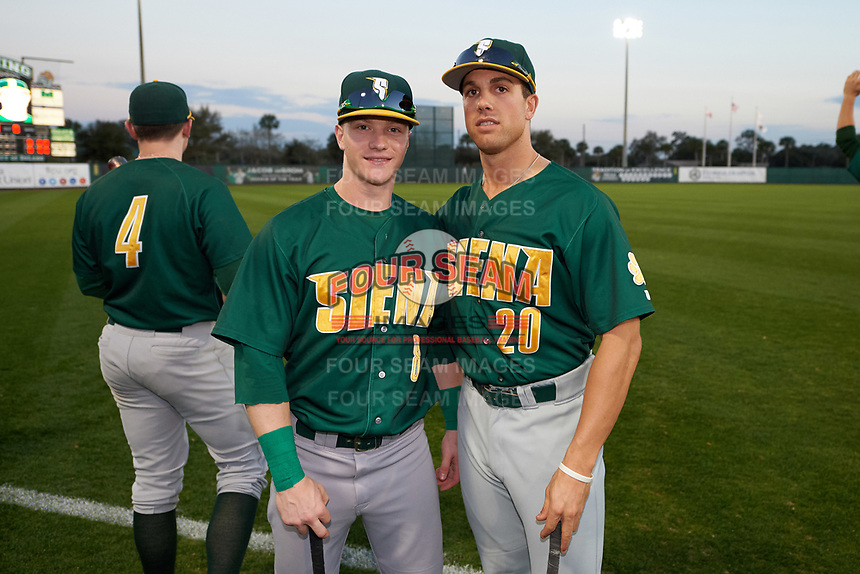 Siena Saints Dan Lowndes (8) and Alex Tuccio (20) before a game against the Stetson Hatters on February 23, 2016 at Melching Field at Conrad Park in DeLand, Florida.  Jordan Bishop (4) is to the left.  Stetson defeated Siena 5-3.  (Mike Janes/Four Seam Images)