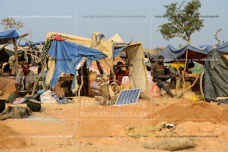 BURKINA FASO , Fada N´Gourma, village TINDANGOU, gold mining Camp PAMA, artisanal gold mines, photovoltaic panel for torch battery recharging