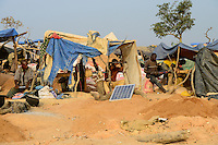BURKINA FASO , Fada N´Gourma, village TINDANGOU, gold mining Camp PAMA, artisanal gold mines, photovoltaic panel for torch battery recharging