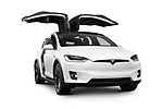 White 2018 Tesla Model X luxury SUV electric car with open falcon wing doors isolated on white background with clipping path Image © MaximImages, License at https://www.maximimages.com