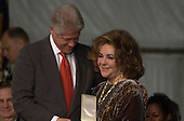 Actress Elizabeth Taylor receives the Presidential Citizens Medal from United States President Bill Clinton in Washington, D.C. on January 8, 2001.  The Presidential Service Medal was established in 1969 to recognize any U.S. Citizen who has performed exeemplary deeds in service to the United States. .Credit: Ron Sachs / CNP