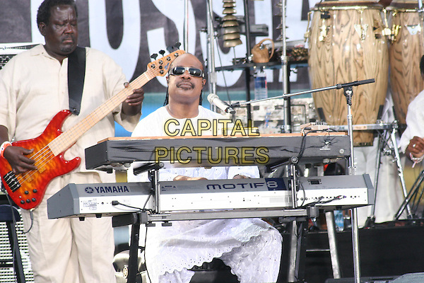 STEVIE WONDER.Performs at Live 8 Philadelphia - A concert to raise awareness for an end to extreme poverty in Africa (Make Poverty History) ahead of the G8 Summit taking place later this week. .Philadelphia Museum of Art, Philadelphia, .Pennsylvania, USA, July 2nd 2005..half length gig makepovertyhistory live8 aid sunglasses playing keyboard.Ref: IW.www.capitalpictures.com.sales@capitalpictures.com.©Ian Wilson/Capital Pictures.