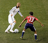 LA Galaxy midfielder and Captain David Beckham (23) dribbles around Chivas USA defender Jonathan Bornstein (13) during the Super Clasico MLS match. The LA Galaxy defeated Chivas USA 5-2 during the SuperClasico at the Home Depot Center Stadium, in Carson, California, Saturday, April 26, 2008.