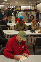 Voters fill out precinct voter's cards at a Columbus, Ohio, early voting center on the first day of early voting in the state..
