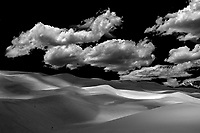 The Great Sand Dune National Park in Colorado.  Expect strong winds, damaging to your camera when visiting this place.  How do you think all this sand got here?