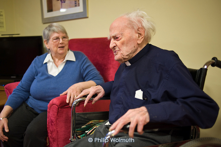 Resident representative June Roberts talks with Reverend Reg Dean, the oldest man in the UK (108), Waltham House Extra Care sheltered housing scheme, Winksworth, Derbyshire, run by Housing 21.