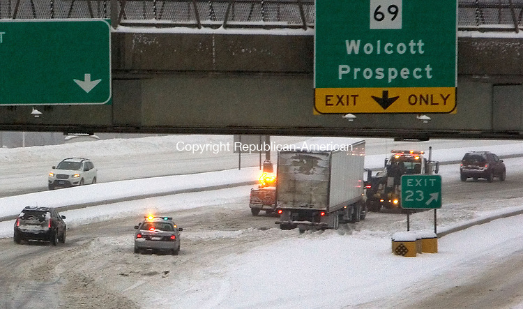 WATERBURY CT. 05 February 2014-020514SV01-A tractor trailer is removed from I84 at Exit 23 after jackknifing into a snow bank and slowing the morning commute in Waterbury Wednesday.<br /> Steven Valenti Republican-American