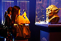 Members of the press take pictures of Yoda's bust during a press tour of the exhibition Star Wars Vision at the Tokyo City View Sky Gallery in Roppongi Hills on April 28, 2015, Tokyo, Japan. The exhibition is divided into six themed areas (Original, Force, Battle, Saga, Galaxy and Droid) located in different halls, and visitors can see models of the battle spaceships, life-size statues of the principal characters and Jedi weapons from the movies. The exhibition also introduces 60 art pieces and 100 movie props. It will open to the public from April 29th to June 28th. (Photo by Lucasfilm/Rodrigo Reyes Marin/AFLO)