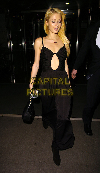 PARIS HILTON.At the Hilton Hotel on Park Lane, London, England,.November 11th 2006..full length black dress steps peep hole cut out .Ref: CAN.www.capitalpictures.com.sales@capitalpictures.com.©Can Nguyen/Capital Pictures