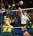 BROOKINGS, SD - OCTOBER 26:  Emily Veldman #12 from South Dakota State tries for a kill past Jenni Fassbender #13 from North Dakota State in the third game of their match Saturday evening at Frost Arena in Brookings. (Photo by Dave Eggen/Inertia)