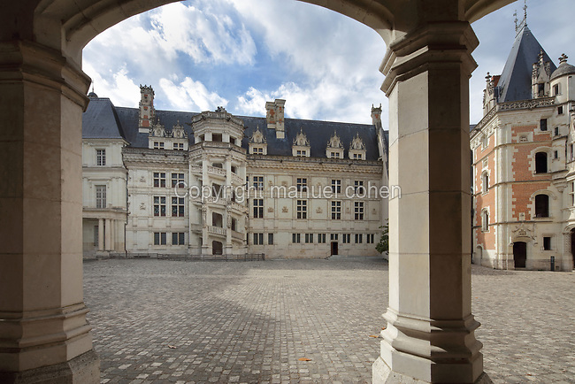 South East facade of the Francois I wing, built 16th century in Italian Renaissance style, with its monumental spiral staircase, seen from the courtyard of the Chateau Royal de Blois, built 13th - 17th century in Blois in the Loire Valley, Loir-et-Cher, Centre, France. On the right is the Louis XII wing, an early 16th century wing in Gothic style with Renaissance elements. The chateau has 564 rooms and 75 staircases and is listed as a historic monument and UNESCO World Heritage Site. Picture by Manuel Cohen